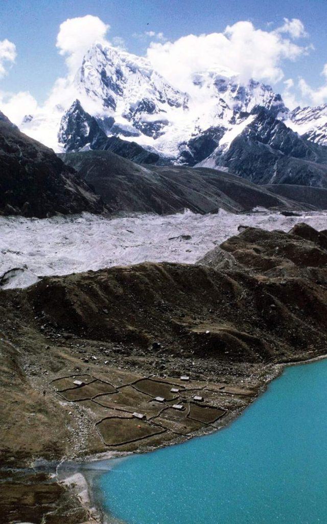 Gokyo from Gokyo Ri in 1985 with yak herder huts, and Ngozumba Glacier
