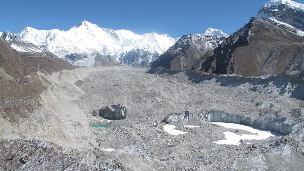 Nepal's longest glacier, Ngozumba is melting due to climate change. Mt Cho Oyu in the background